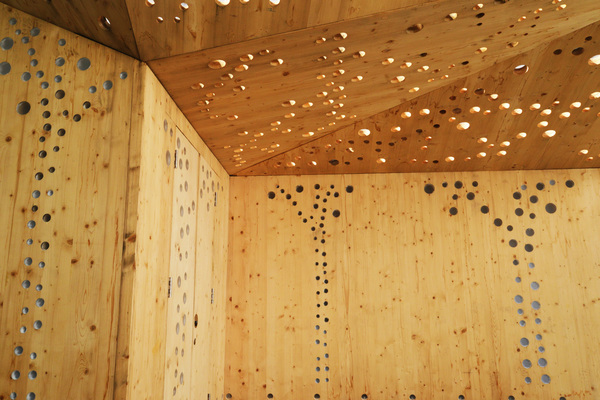up close view of timber stall artwork