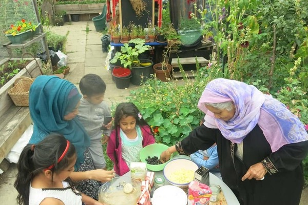 Residents making pizza at the Canal Club community garden