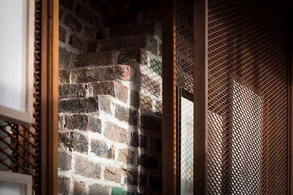 Detail of perforated Corten Steel picture storage screens