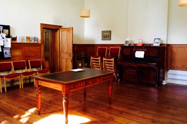 The panelled library room with double door entrance to the meeting room