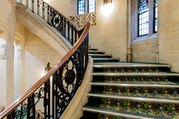 Staircase showing original stained glass and light fittings from Middlesex Guildhall period