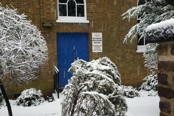 House and garden in December snow
