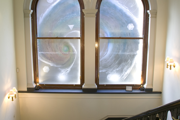 Windows designed and produced in 2007 by Sally Scott, featuring a cosmic spiral and the Society's motto QUICQUID NITET NOTANDUM (Whatever shines should be observed).