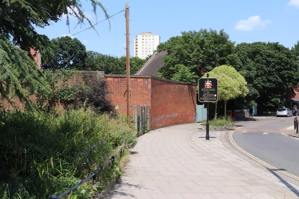 Rufford Tower in background (built on former Co-op jam factory site) seen from Woodlands Park entrance