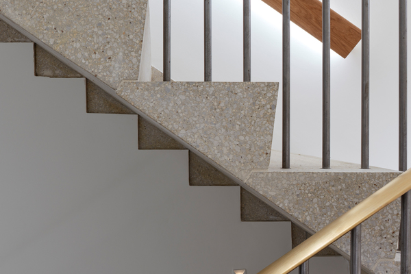 Cantilevered terrazzo stair and bronze handrail