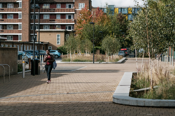 View down the new pedestrian 'street' with rain basins and permeable paving
