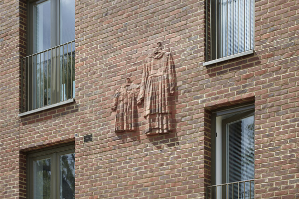 One of four brick reliefs