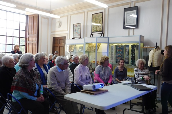 RSN Embroidery Studio Tour attendees listening to the Tour Presentation