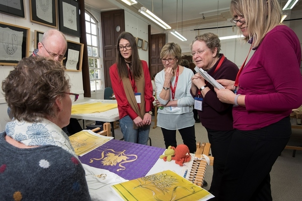 RSN Tour Group speaking with Embroidery Studio Stitcher