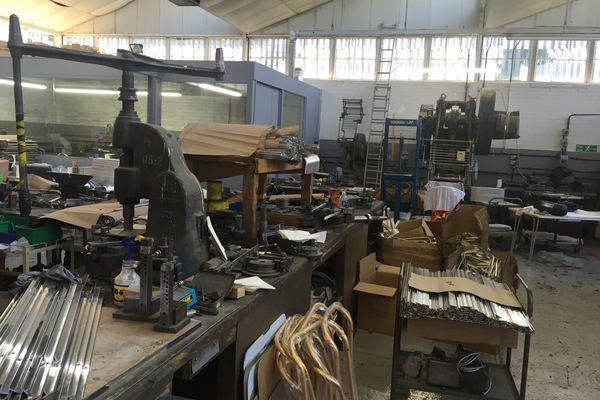 Looking across the bending bench towards the polishing shop and big Bentley power press.