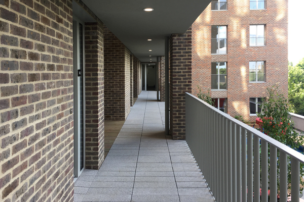Access deck between two towers, level 1 garden below and to the right