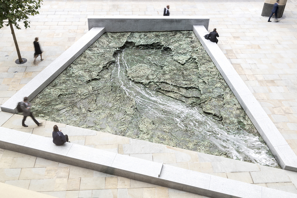'Forgotten Streams',  a public artwork by Cristina Iglesias, defines two of the public plazas surrounding the site.