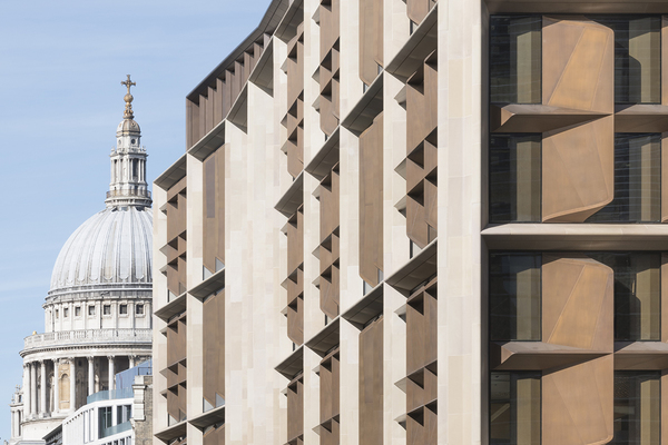 The building's design is sympathetic to its historic neighbours, including the iconic St. Paul's Cathedral.