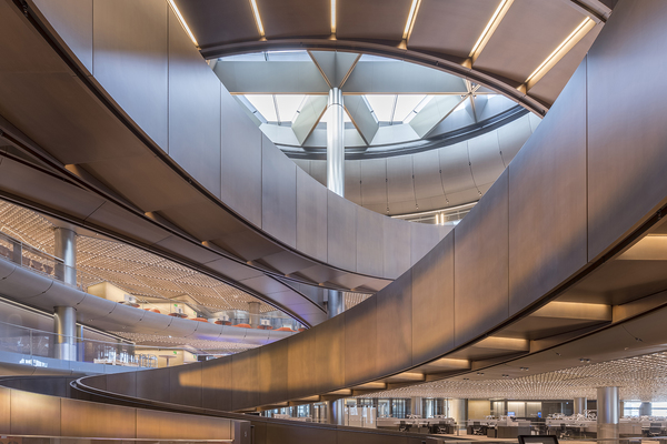 The centrepiece of the building's interior is a spiralling ramp spanning nearly 700 feet and six floors in a triple-helix formation. It is designed and proportioned as a place of meeting and connection