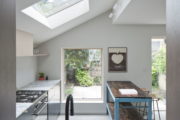 View through picture window into kitchen