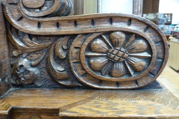 Carved  wooden decoration on oak cabinets
