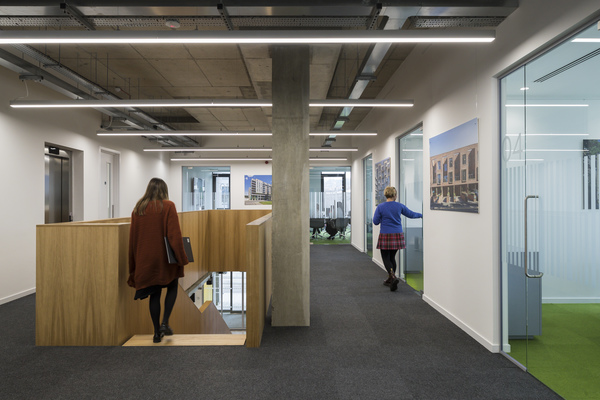 The meeting rooms have floor to ceiling windows and transparent doors to allow light to flow through the building