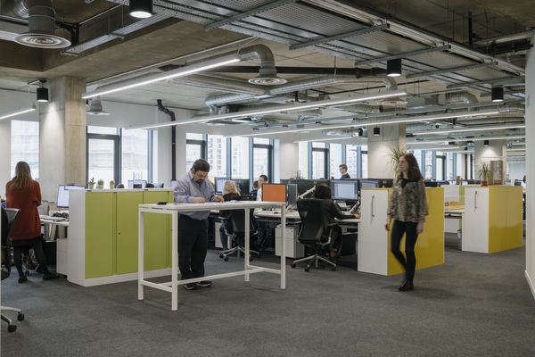 Breakout spaces are dotted throughout the open plan office