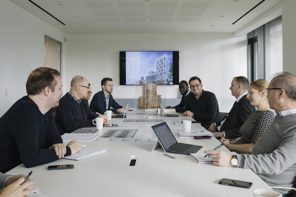 Full to ceiling windows in meeting rooms let natural light into the building
