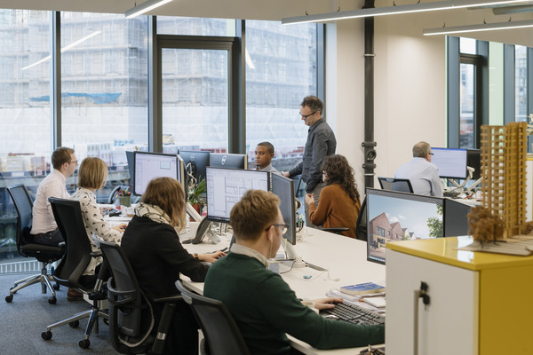 The large open plan office space has allowed more space for every staff member, with dual screens at every desk and storage on every row