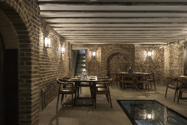 Basement function room, featuring restored original brickwork and Yorkstone flooring