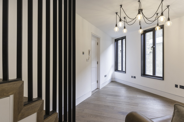 The maisonette flat located in the New Build upper floors features more contemporary detailing and fittings