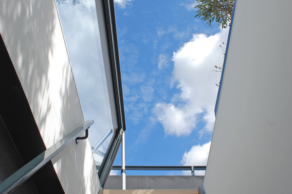 A new staircase ascends to the terrace via an electrically operated rooflight