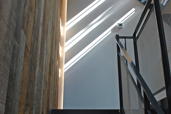 Sunlight casts through the staircase to animate the space