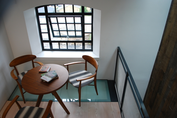The new upper mezzanine provides a seating area with views over the city