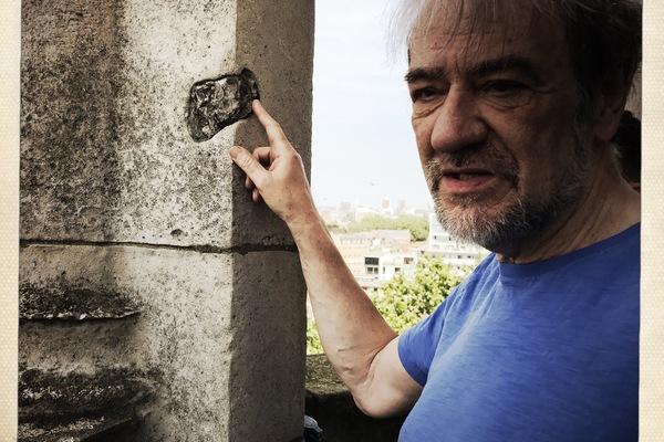 Rev Paul Turp shows WW2 shrapnel damage to cupola, St Leonard's Shoreditch