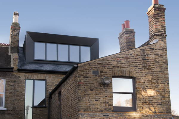 Black zinc clad dormer and double height slot window