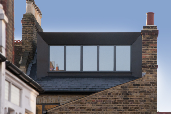 Black zinc dormer with full-width picture window