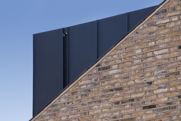 Zinc cladding detail with integrated rainwater channel