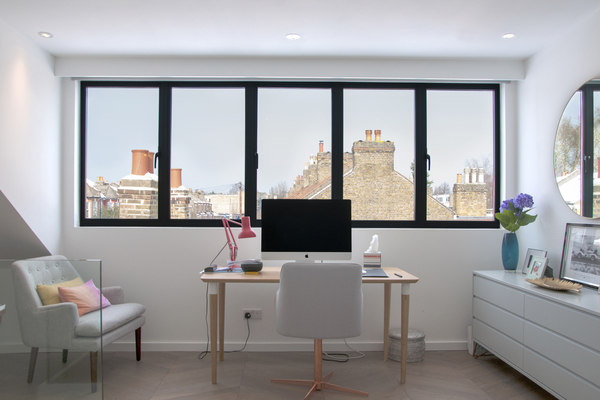 Picture window in loft room overlooking surrounding roofscape