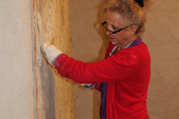 Lime plastering the inside walls by hand