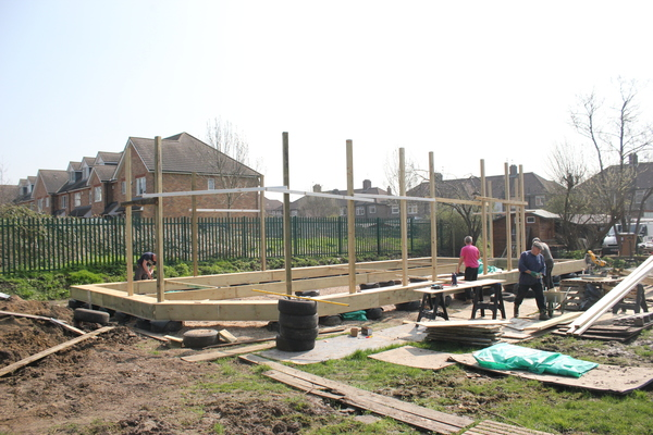 Building the wooden frame to support the straw bales