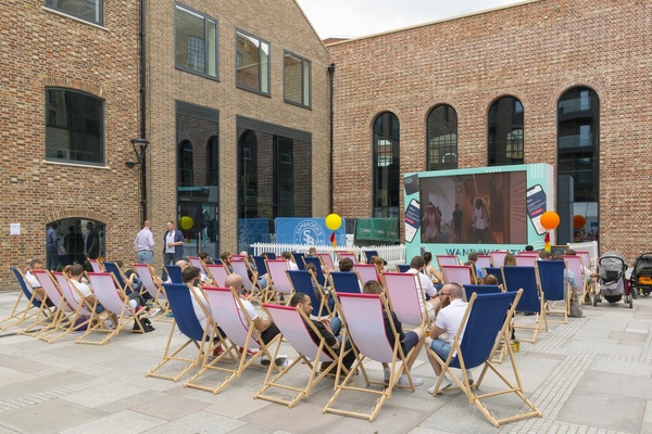 """Bubbling Well Square, Ram Quarter (""""Tennis in the Square"""" event, summer 2019, against backdrop of old brewery buildings)"""
