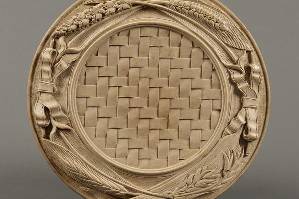A George Wing basket weave bread platter