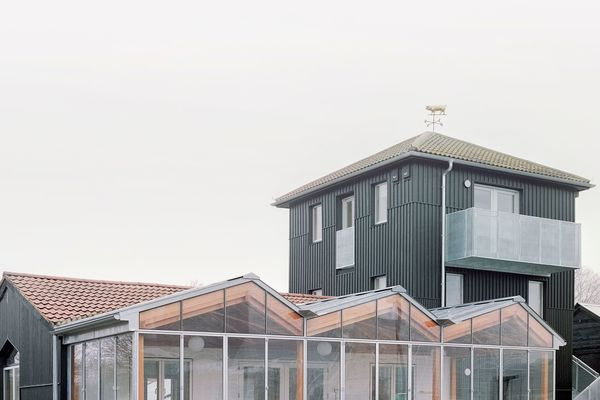 new orangery and newly clad tower with golden pig weathervane