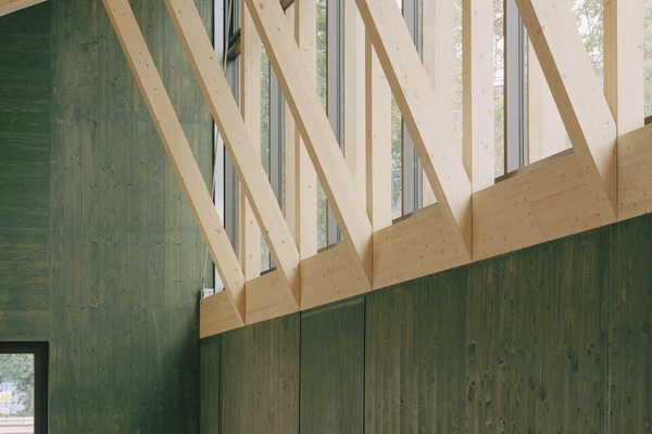 Clerestory provides natural light and a link to the outdoors. Natural materials have been chosen throughout to echo surrounding environment. Services run in a buried trench to avoid disrupting the lines of exposed CLT elements.